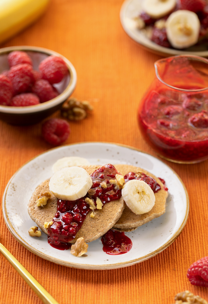 Vegan Banana Oat Pancakes with berry sauce