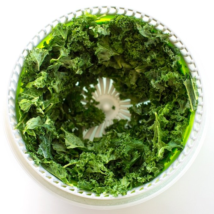 Fresh green kale in salad spinner