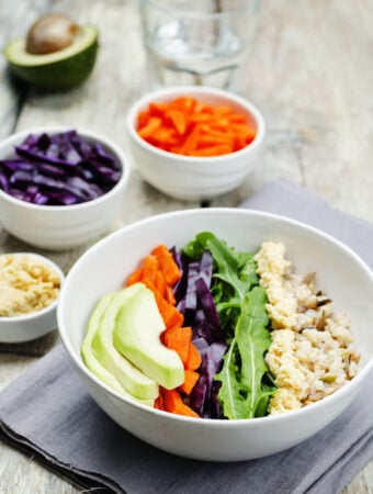 hummus and vegetable bowl on cooked grain