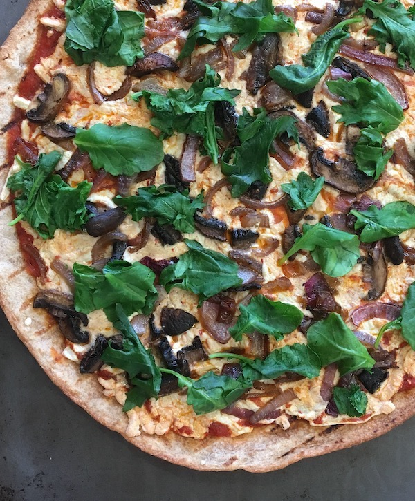Red Onion, mushroom, and kale pizza