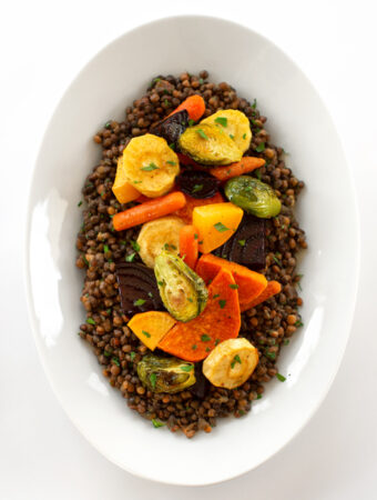 Roasted root vegetables on lentils