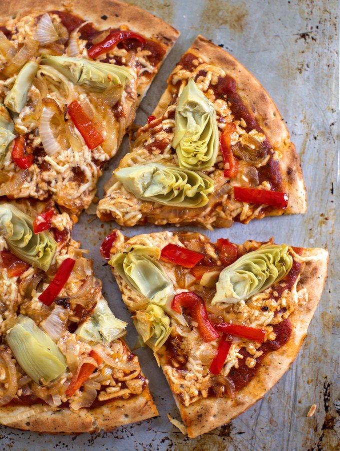 Vegan artichoke and red bell pepper pizza