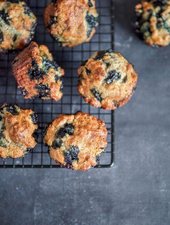 Vegan lemon Blueberry Muffins On a Cooling Rack
