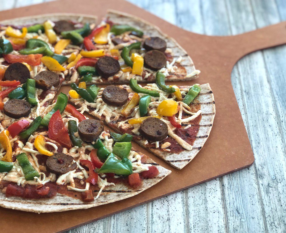 Vegan sausage and peppers pizza on whole wheat crust