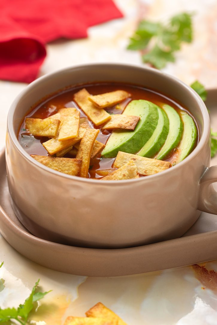 Tortilla soup with summer squash, corn, and avocado