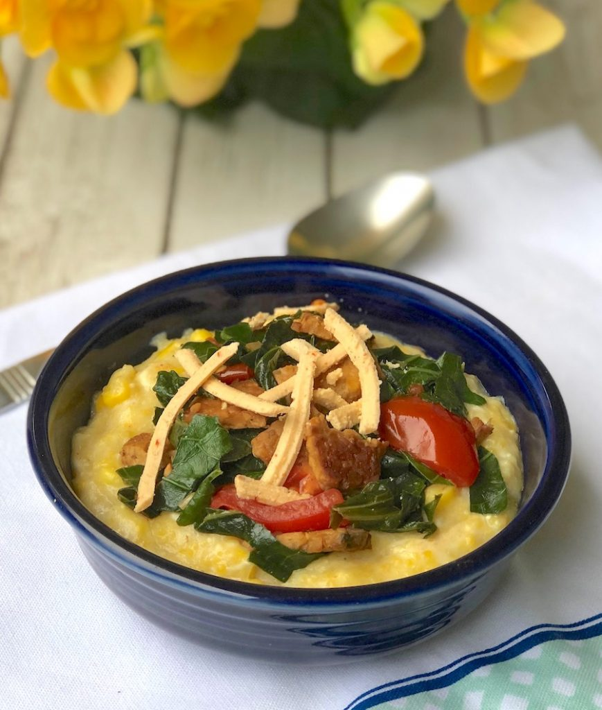 Vegan Cheese grits with greens and tempeh bacon