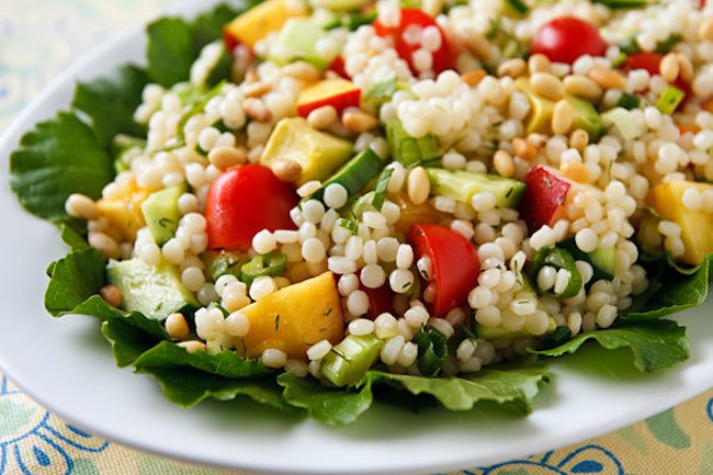 Israeli couscous salad with tomatoes, cucumber, and avocado
