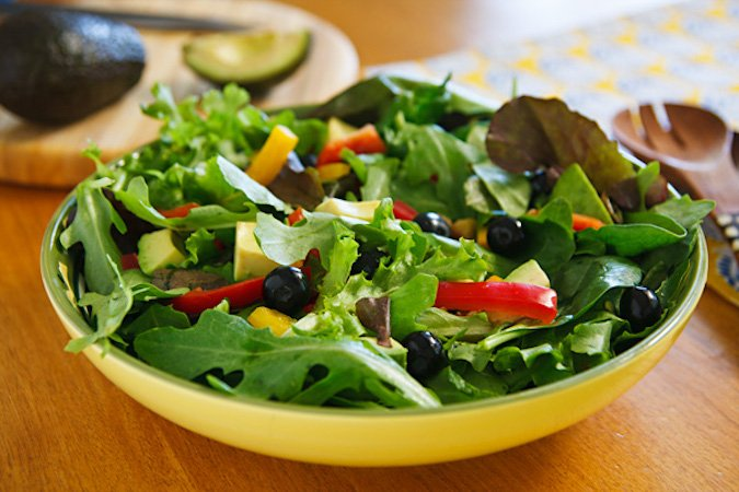 Mixed greens salad with blueberries and avocado