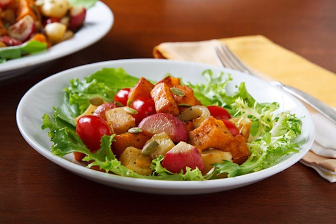 Roasted root vegetable salad on greens