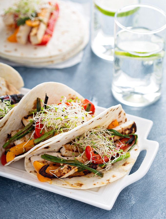 Vegan tacos with grilled tofu, herbs and vegetables
