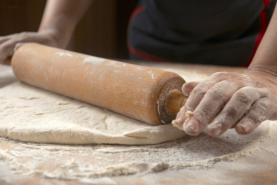 Rolling out homemade pizza dough
