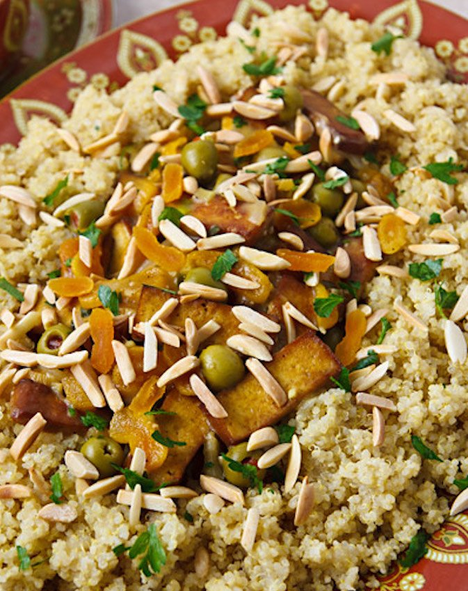 Moroccan-Flavored Tofu with Apricots, Almonds, and Olives on couscous or quinoa