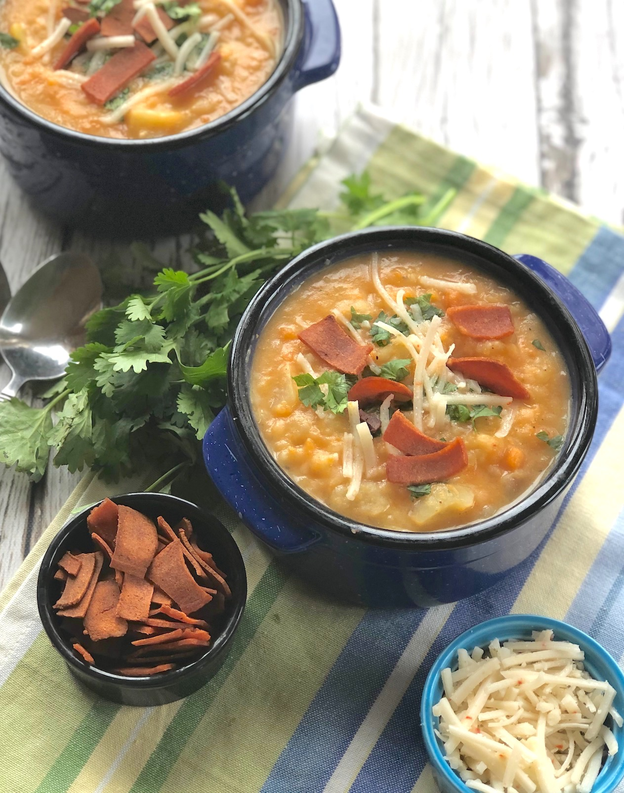 Two-potato soup with vegan bacon and vegan cheese