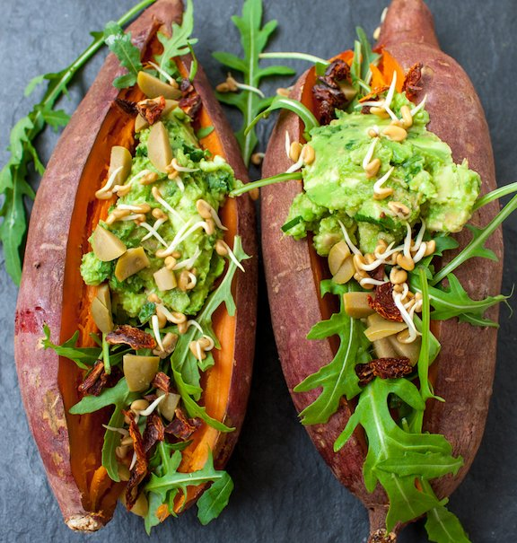 Arugula, olive, and avocado stuffed sweet potatoes