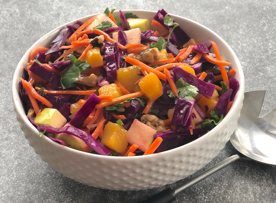 Fruity red cabbage salad with apples, mango, and nuts