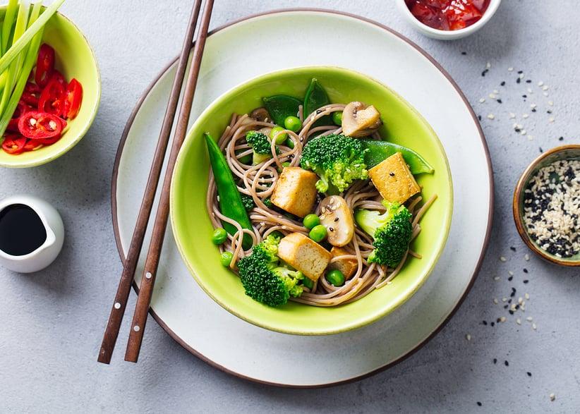 Stir-fried soba noodles with tofu, broccoli, and snow peas
