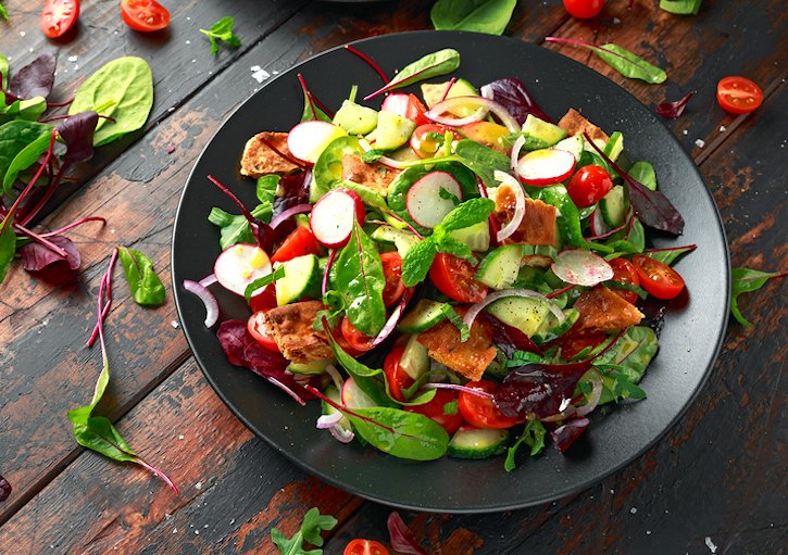 traditional Middle Eastern Fattoush Salad (fattouche) with toasted pita bread