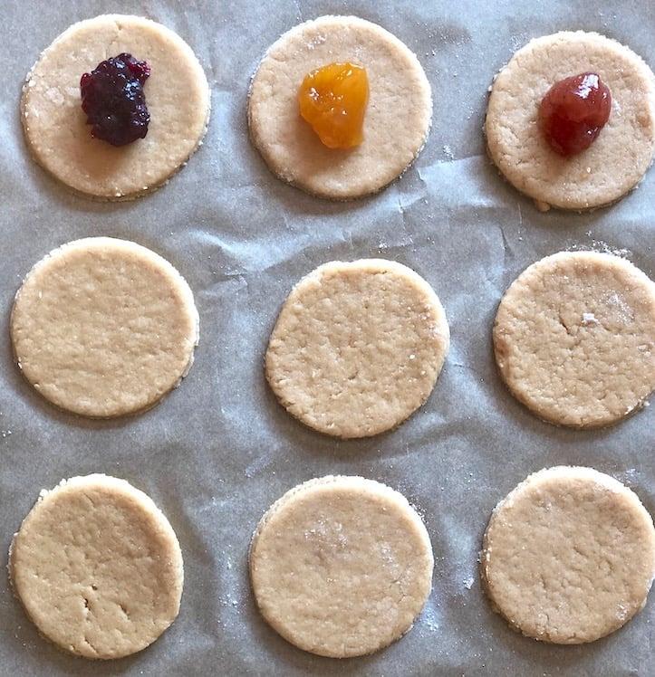 Placing jam on vegan hamantaschen dough
