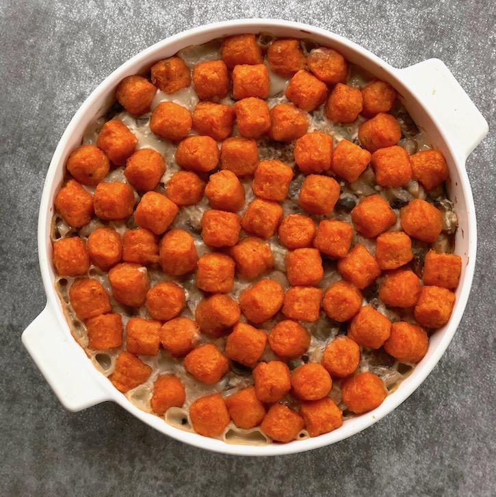 Vegan hotdish casserole made with sweet potato tots