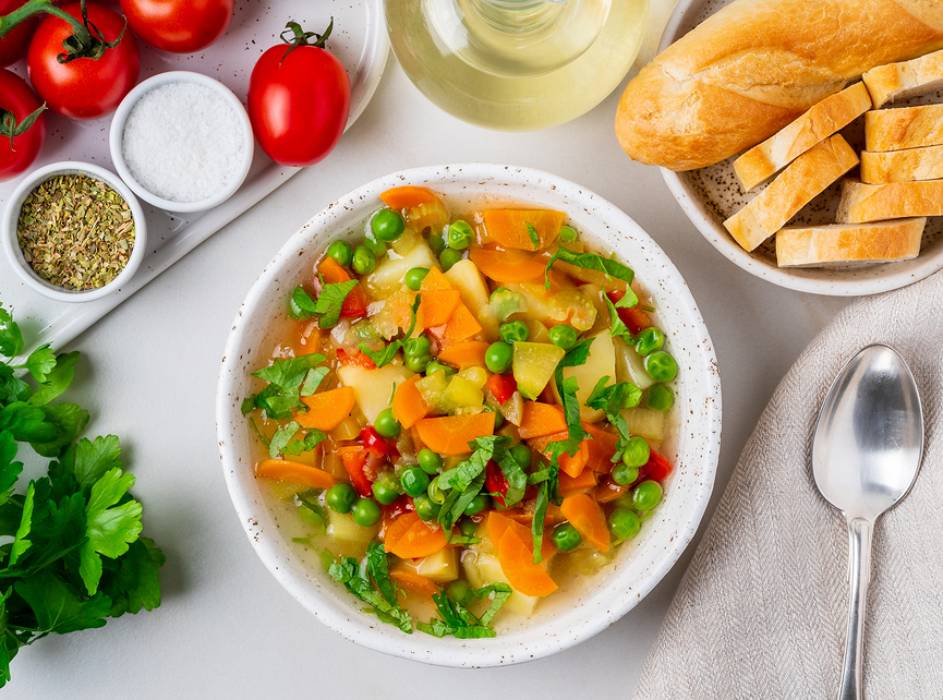 Spring vegetable soup with potatoes, carrots, and peas