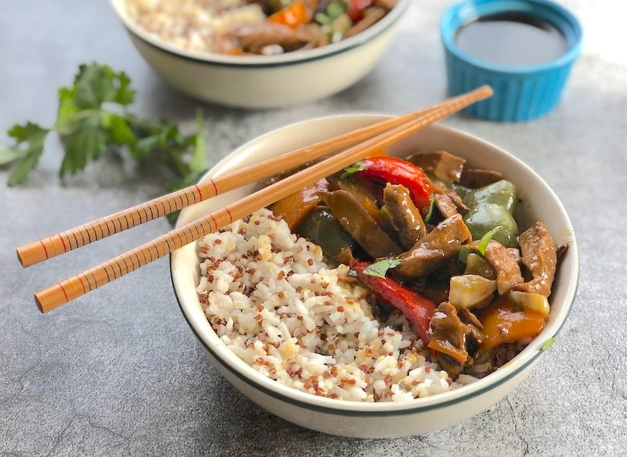 Vegan pepper steak served with rice
