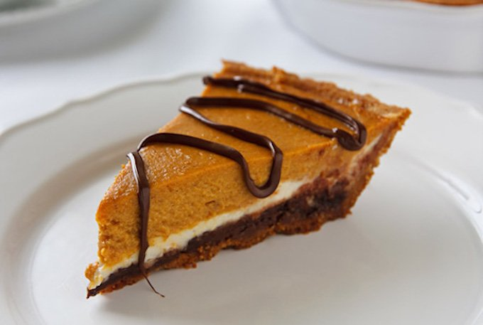 pumpkin or butternut squash cheesecake with chocolate drizzle