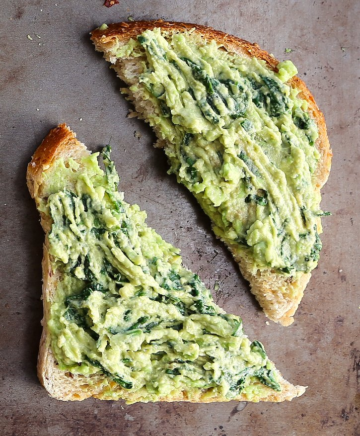 Avocado toast with wilted spinach