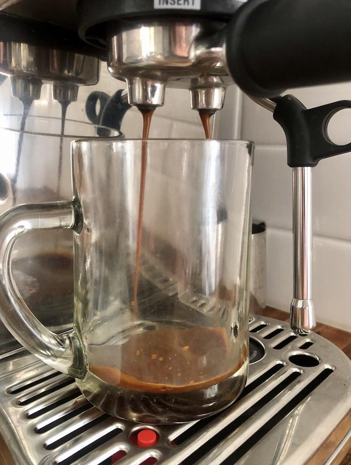 Pulling espresso into a mug