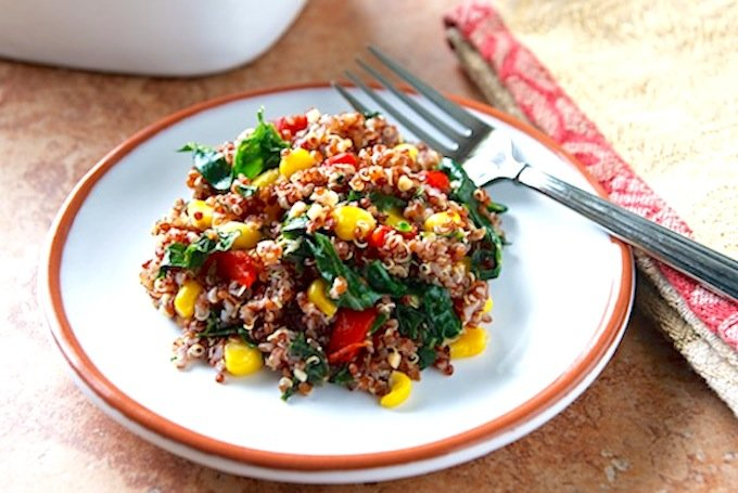 Red quinoa pilaf with corn and kale