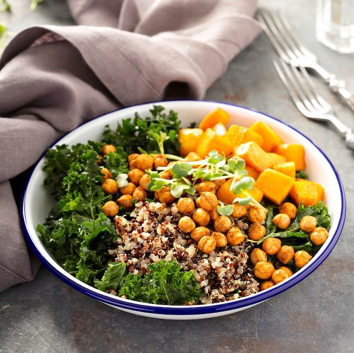 Autumn Buddha Bowl with kale, chickpeas, and squash