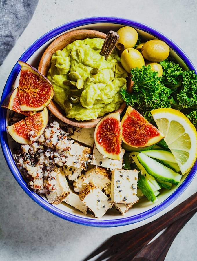 Buddha Bowl With Quinoa, Tofu, Kale, Figs And Guacamole