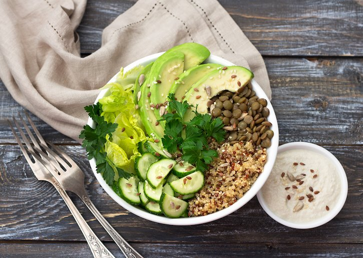 Green Buddha Bowl With Lentils, Quinoa, Avocado, Cucumber, Lettuce, and Tahini dressing