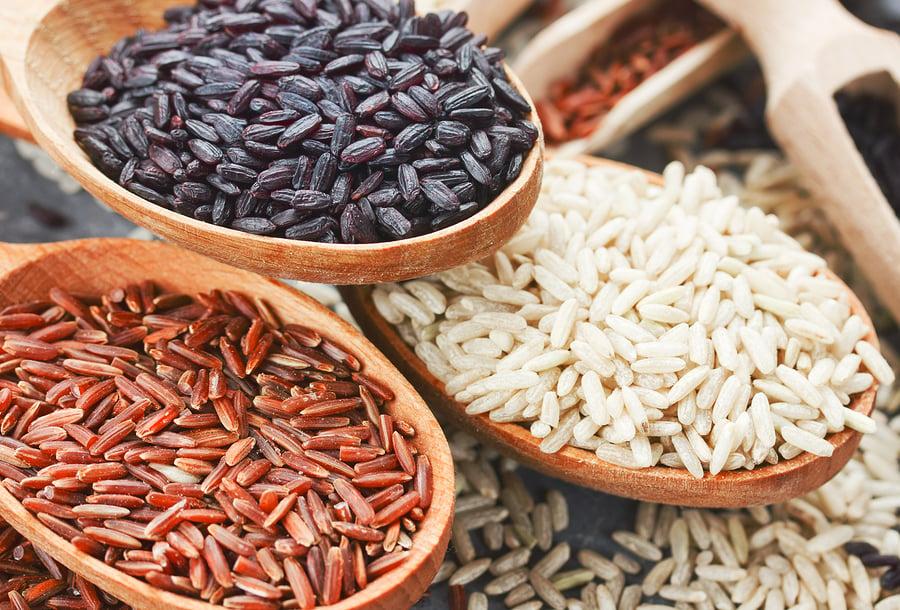 Gourmet rice varieties in wooden spoons