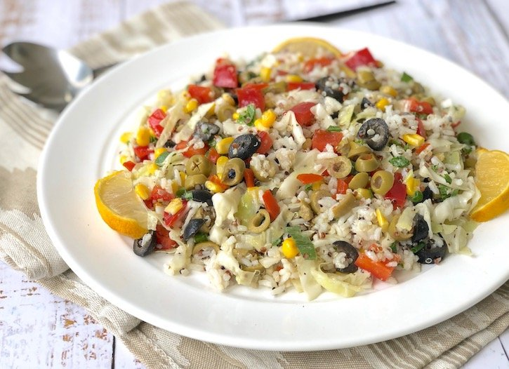 Rice and corn salad with black and green olives
