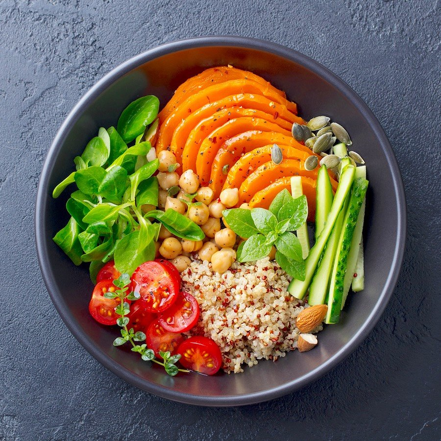 Roasted squash bowl with quinoa tomatoes & greens