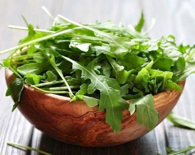 Arugula leaves in bowl