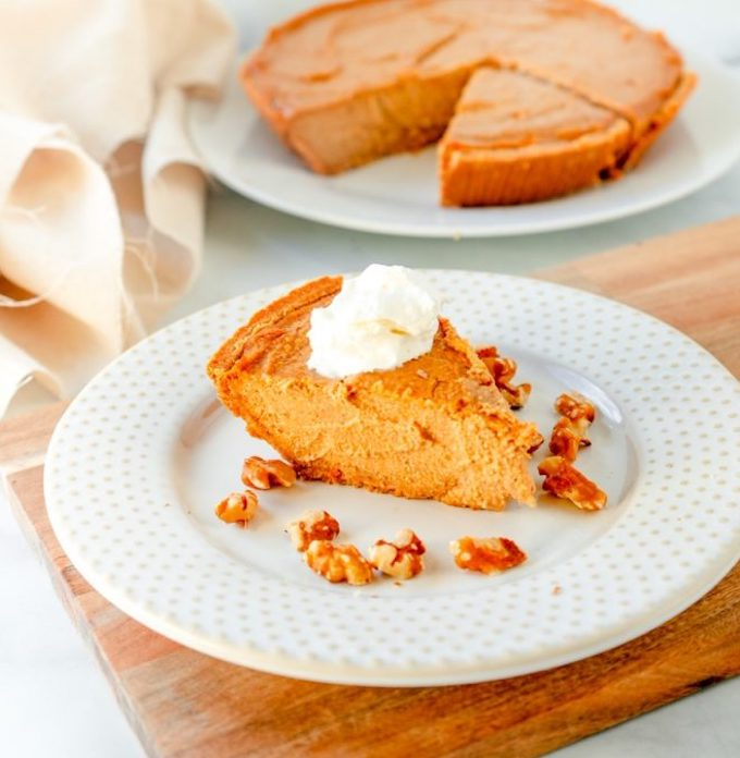 Vegan pumpkin cheesecake with whipped topping