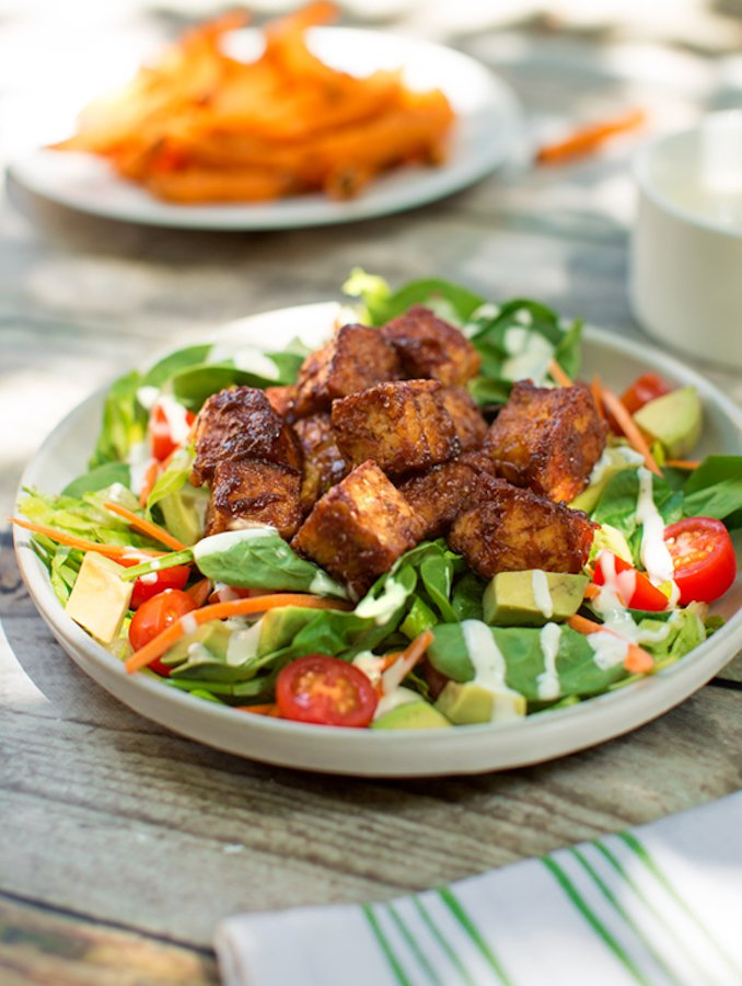 BBQ Tempeh salad served with sweet potato fries