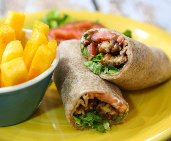 Tempeh, lettuce, and tomato wraps