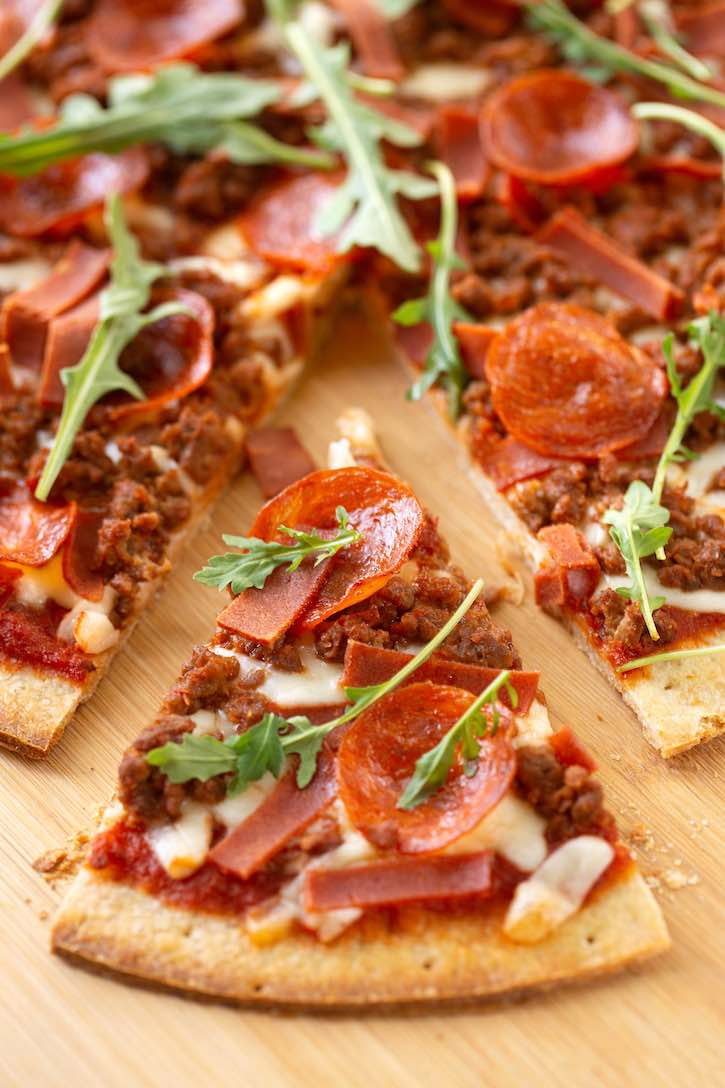 Vegan Meat Lovers Pizza made with plant-based ground, bacon, & pepperoni