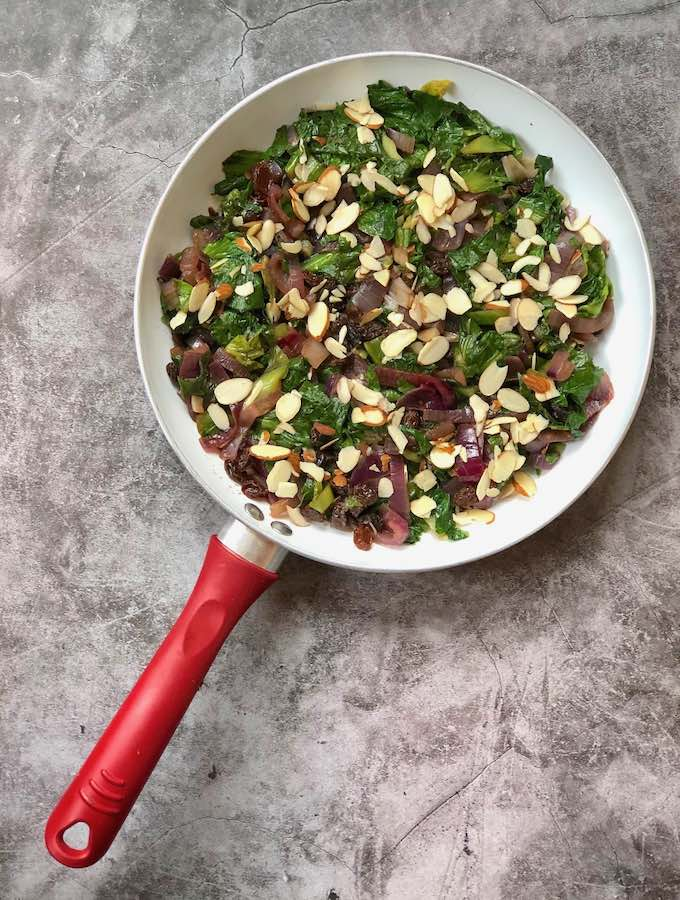 Escarole with red onion, raisins, and almonds