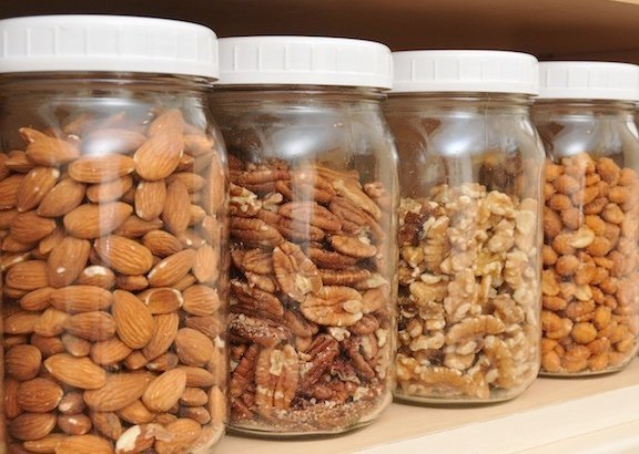 a variety of nuts in jars