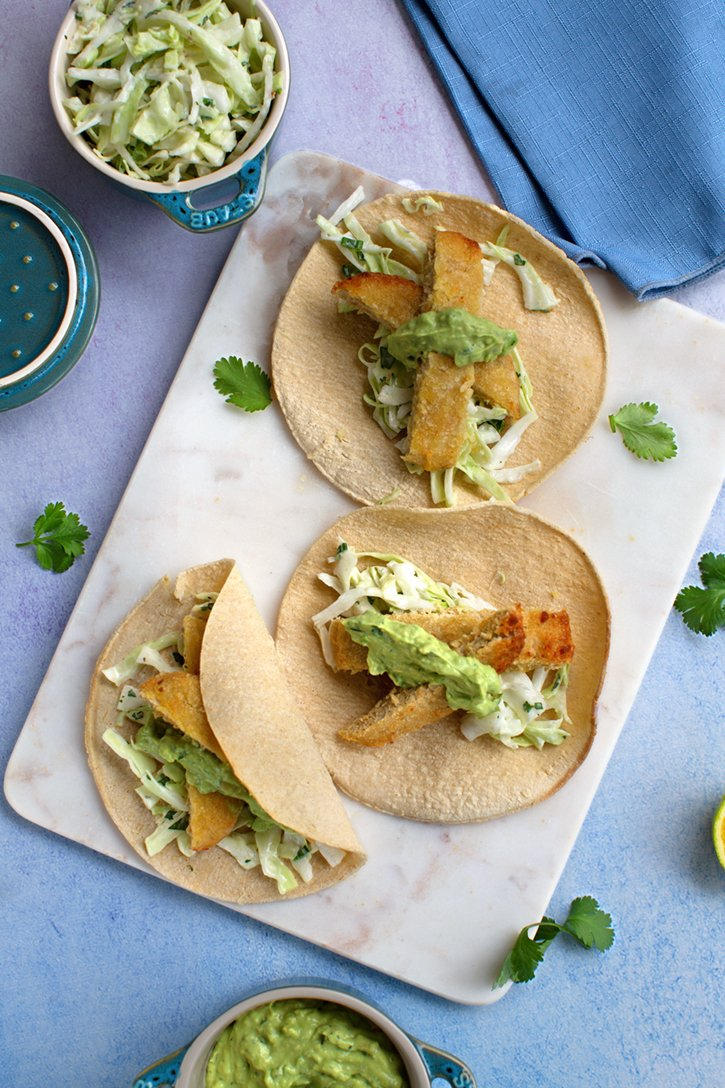 Vegan Fish Tacos with Avocado-Cilantro Cream and creamy slaw