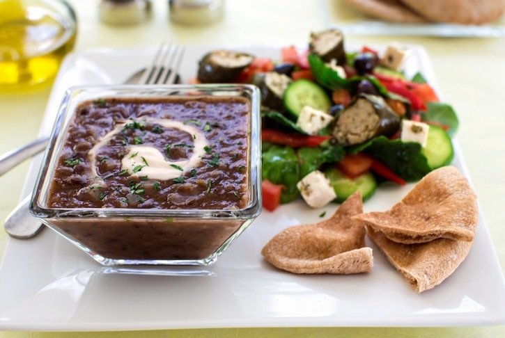 Quick black bean soup served with Greek salad