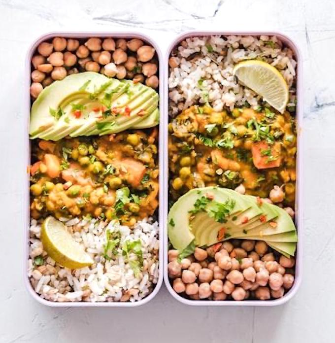 Meal prepping with grains, curry, and avocado