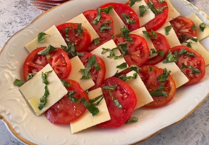 Tomatoes, basil, & plant-based mozzarella (vegan Caprese salad)