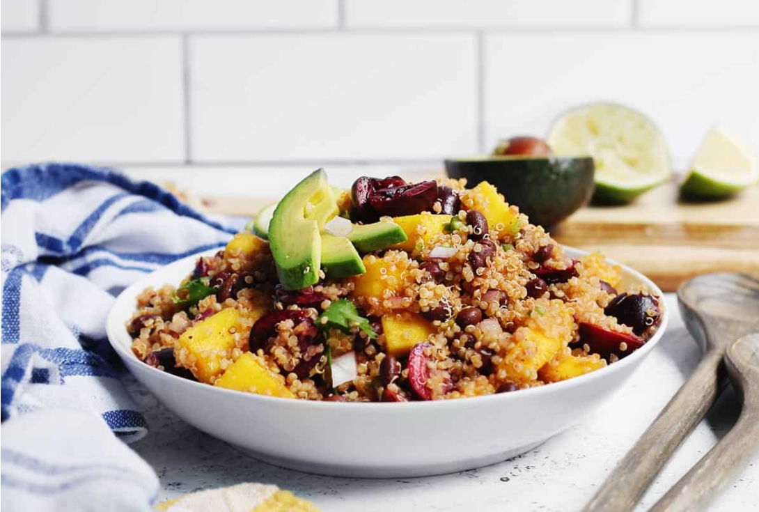 Black bean quinoa salad with mango and cherries