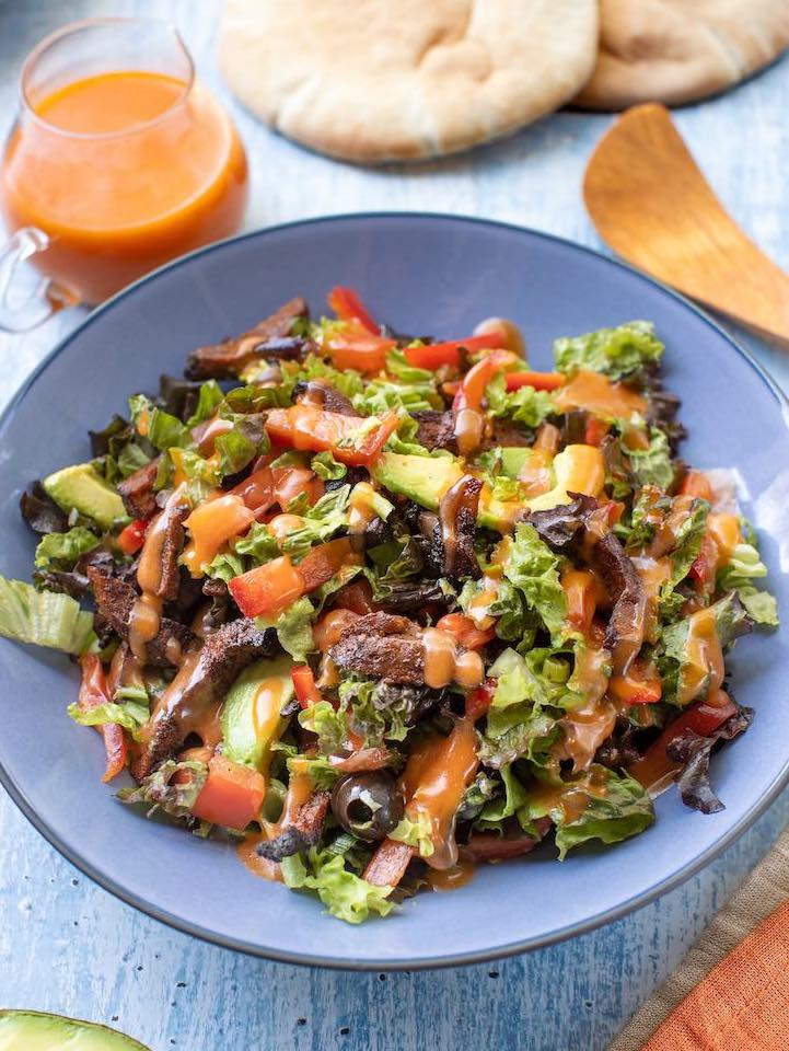 Hearty Seitan salad with tomatoes and avocado