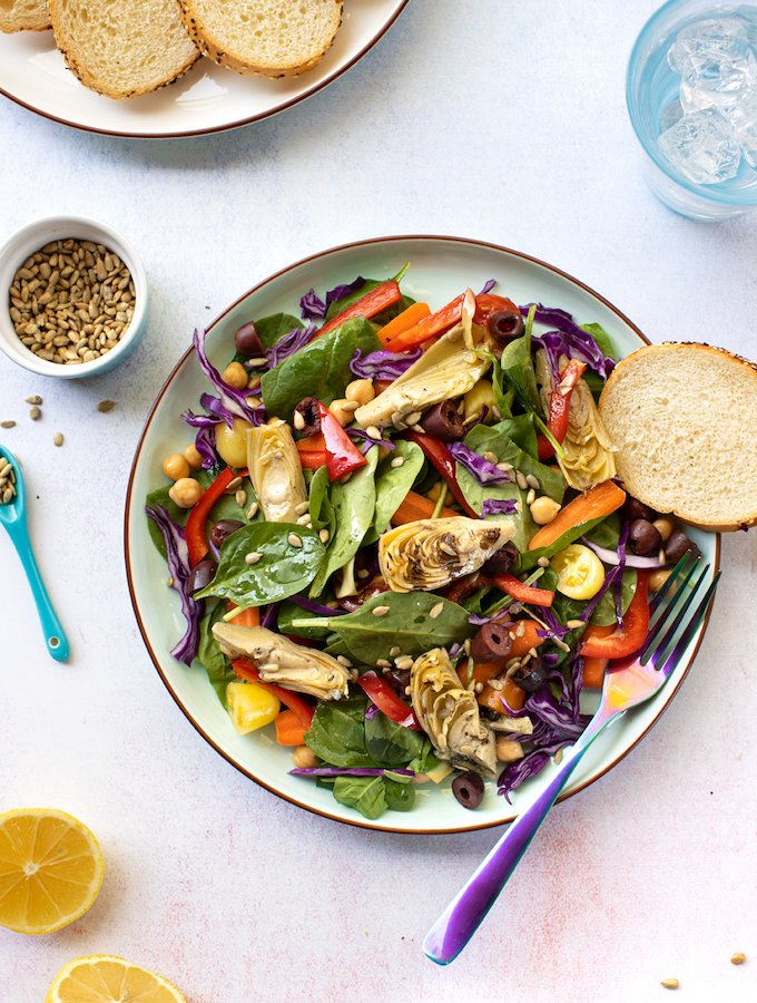 Spinach and artichoke salad with chickpeas and olives