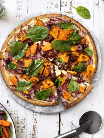 Vegan Sweet potato pizza with onions, olives, & spinach